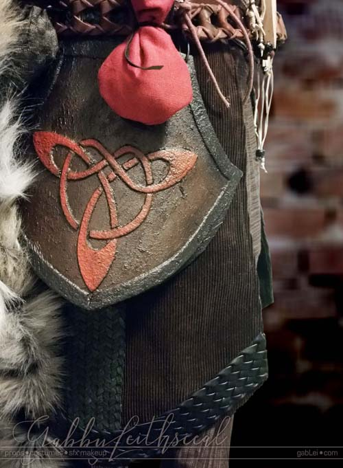 Close up of The Beast costume hip armor and detail of contrasting textures and layers, with a small medieval style belt bag.