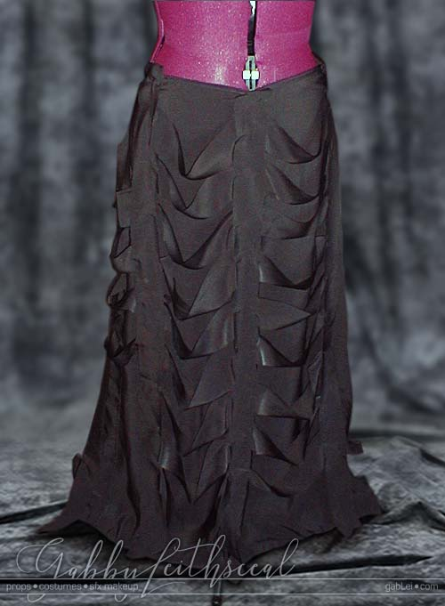 Dark Lily costume's long black skirt on a dress form.
