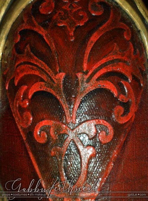 Close up of red jacket shoulder filigree detail