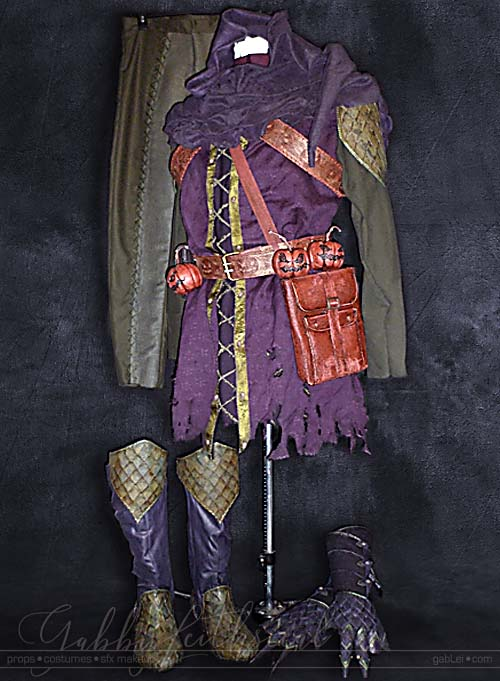 Full view of medieval green goblin costume on sewing form.