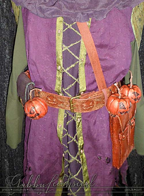 Front veiw of medieval green goblin costume on sewing form.