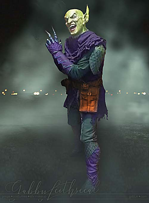 Man in full Green Goblin costume and mask.