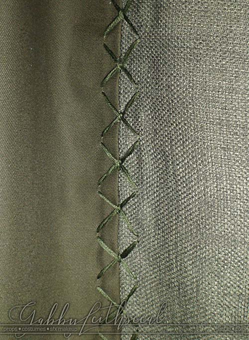 Close up of two textures and stitch work on the green goblin costume pants.