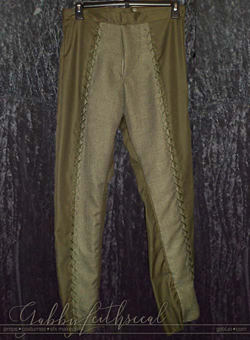The green goblin costume's two tone green pants with cross stitch detail.