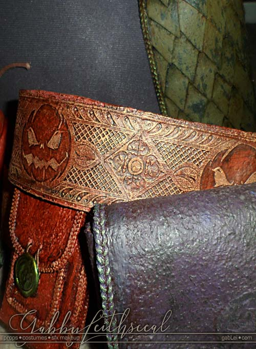 Grouping with orange pumpkin belt, prple pouch, oranage pouch and green scale armor for the green goblin costume.