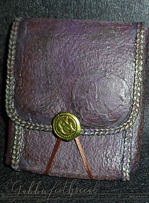 Purple leather like pouch with green trim for the green goblin costume.