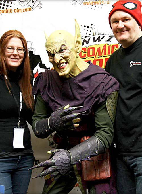 Gabby Leithsceal and Scott Mitchell standing next to an actor in the Green Goblin costume and mask at convention.
