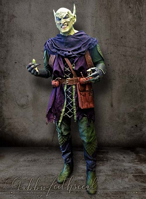 Full veiw of medieval green goblin costume and mask.