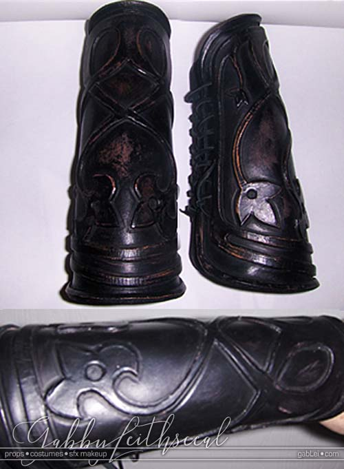 Prince Nuada costume black leather lace up bracers with stylized vine like intertwined flower detail.
