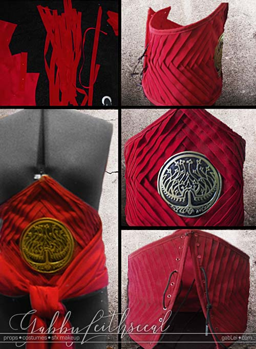 Making the Prince Nuada costume red, wide, corset style belt with a gold and black stylized tree of life seal in the center.