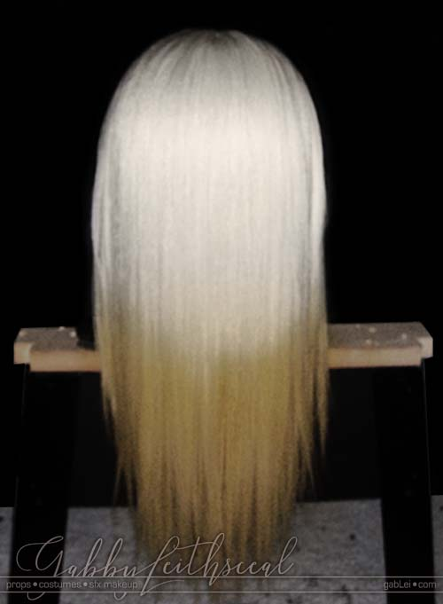 Back view of Prince Nuada costume's long, white to yellow gradient, hand laced wig.