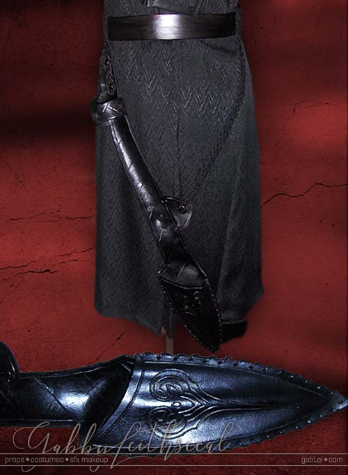Prince Nuada costume black leather belt with hip mounted leather spear sheath, detailed with stylized long heart.